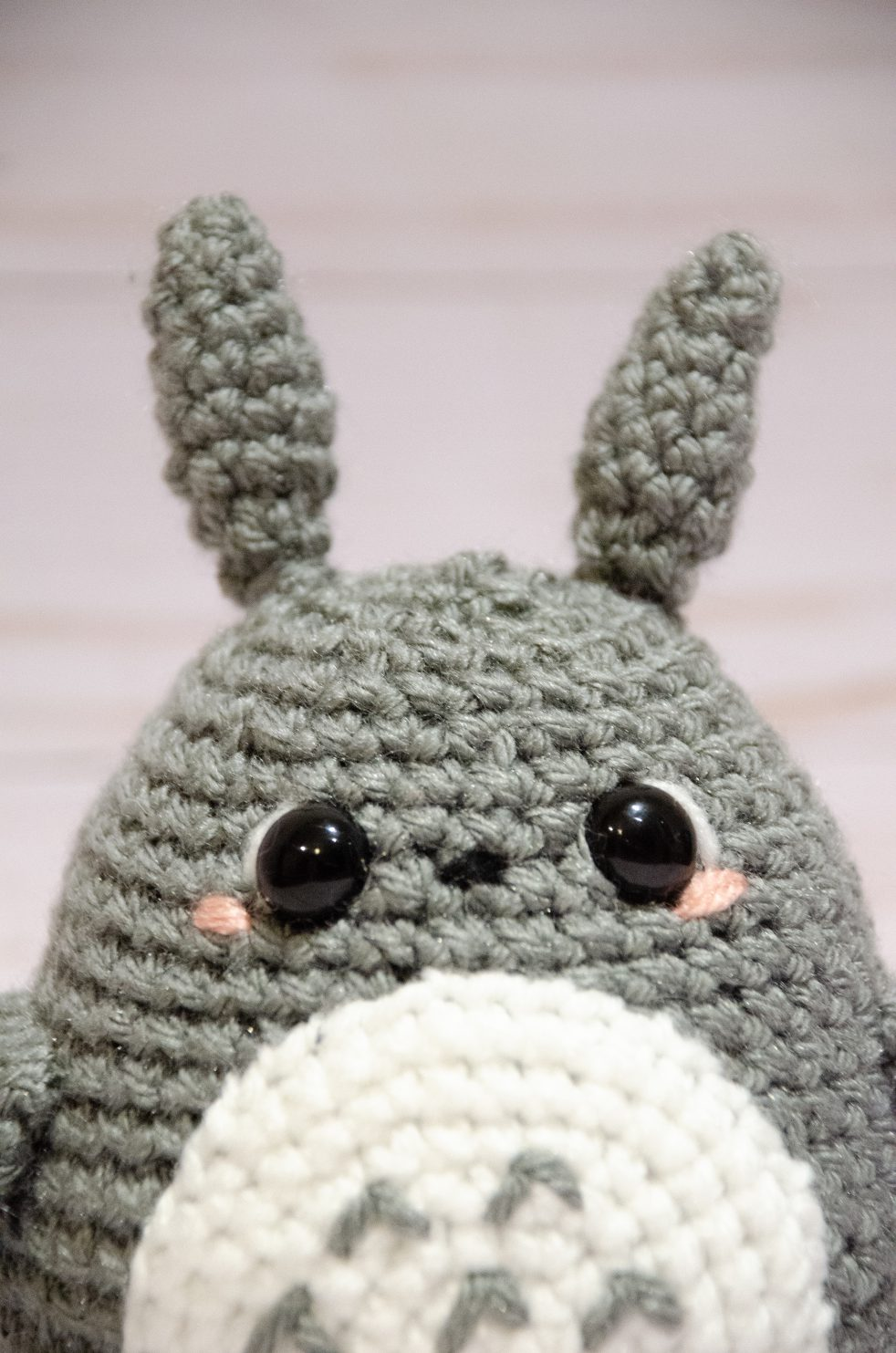 up close photo of crochet totoro